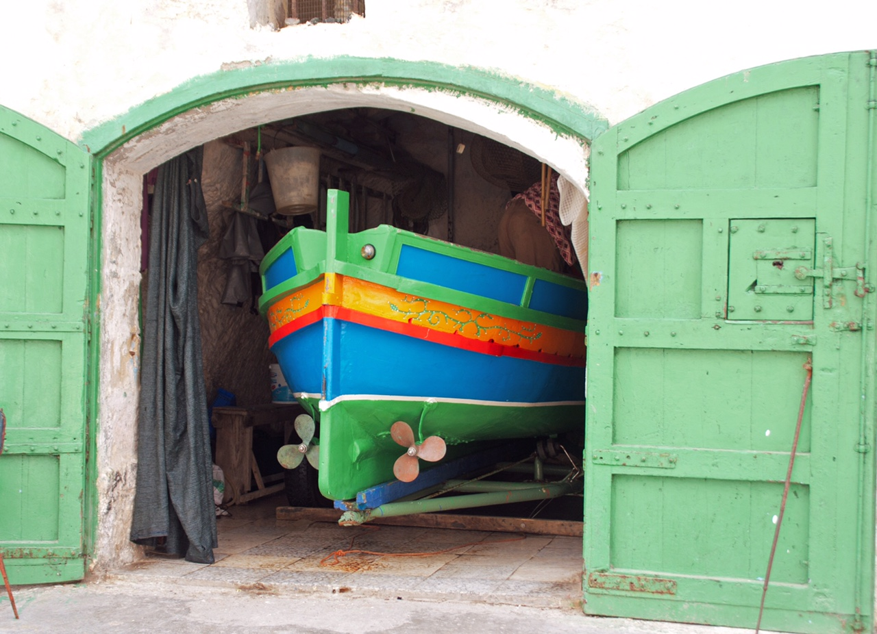 Colourful Gozo boathouse