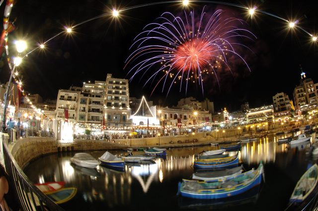 Fireworks over the water in St Julians